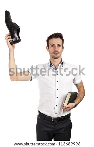 Man showing a shoe and the other hand holding a book isolated on white