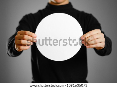 Man showing blank round white paper. Leaflet presentation. Pamphlet hold hands. Man show clear offset paper. Sheet template #1091635073