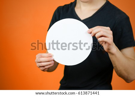 Man showing blank white rounded flyer brochure booklet. Leaflet presentation. Pamphlet hold hands. Man show clear offset paper. Sheet template. Booklet design sheet display read first person #613871441