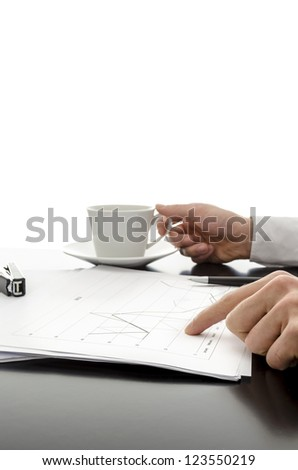 Man showing business documents and drinking coffee.