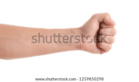 Man showing fist on white background, closeup of hand #1259850298