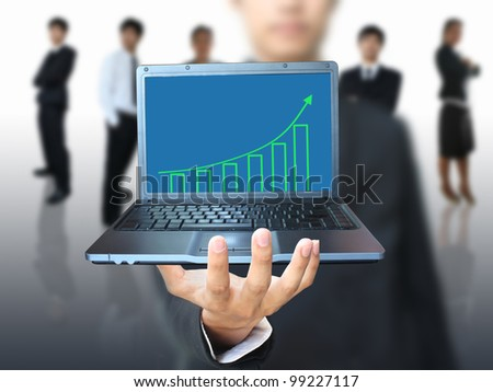 Man showing growth graph in laptop
