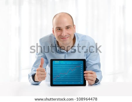 Man showing growth graph on a digital tablet