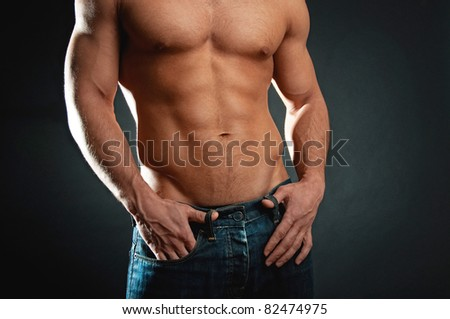 Man showing his muscular body
