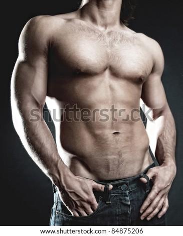 Man showing his muscular body