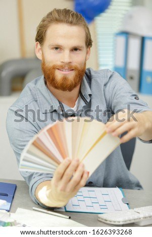 man showing swatches to customer