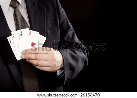 Man showing winning hand with four aces