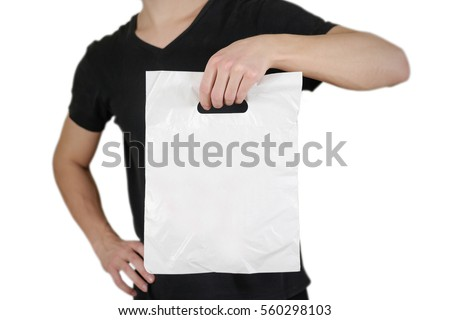 Man shows blank plastic bag mock up isolated on white background. Empty white polyethylene package mockup. Consumer pack ready for logo design or identity presentation.