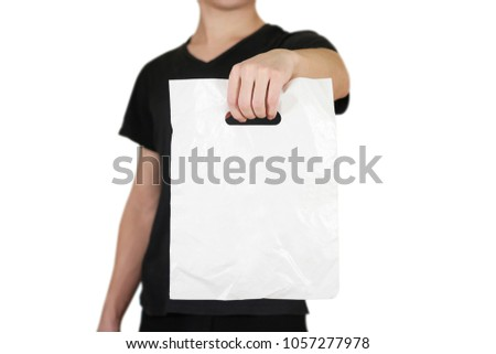 Man shows blank plastic bag mock up isolated on white. Empty white polyethylene package mockup. Consumer pack ready for logo design or identity presentation. Commercial product food packet handle.