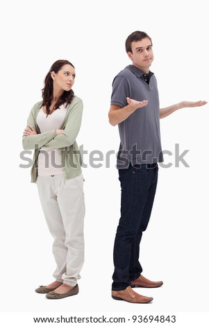 Man shrugged his shoulders back to back with woman against white background