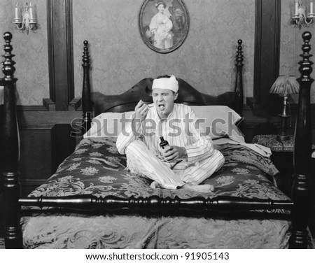 Man sick in bed - stock photo