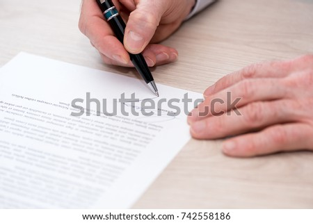 Man Signing A Legal Document EZ Canvas - Signing legal documents