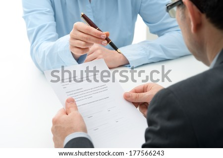Man signs purchase agreement for a  house