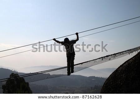 Man silhouette on radical bridge
