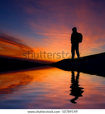 Man silhouette on sunset sky background