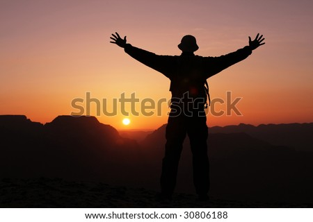 man silhouette on the sunset
