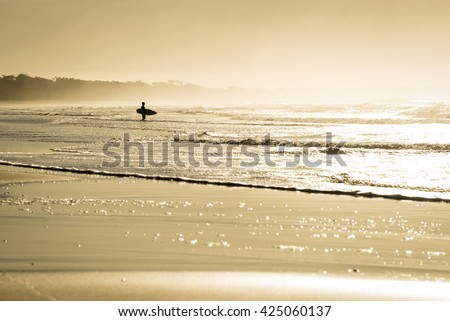 man silhouette with surfboard...