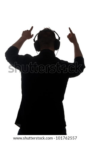 Man silouette with ear-phones listening to music against white background.