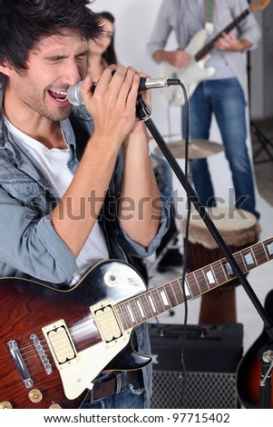 Man singing in a band