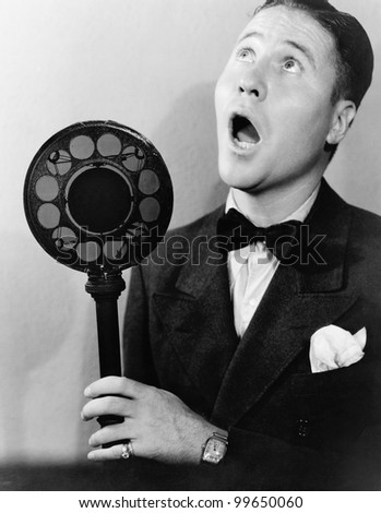 Man singing with radio microphone