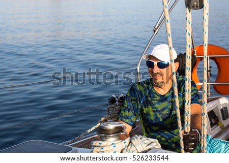 Man sits on his sailing yacht. #526233544