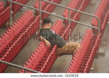 Man sits out rain delay