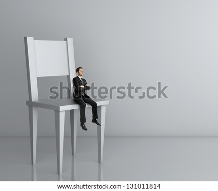 man sitting a big chair - stock photo