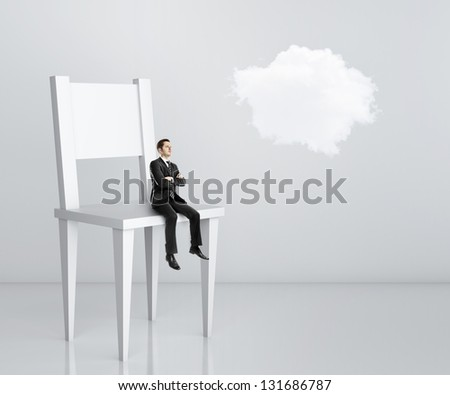 man sitting a big chair and cloud