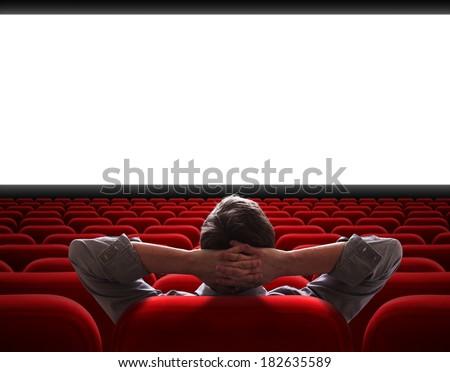 man sitting alone in empty cinema hall