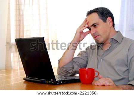 Man sitting at a desk and looking into his computer
