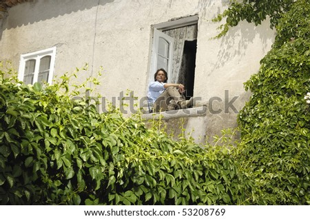 Man sitting at a window