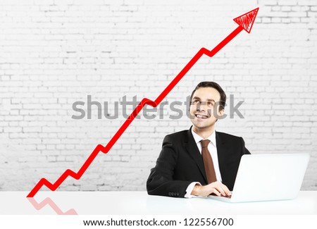 man sitting at table and graph of growth