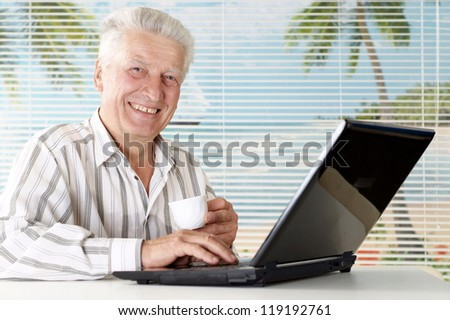 man sitting at the laptop on a light background