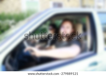 man sitting in the car ,blurred background #279889121