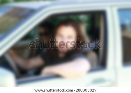 man sitting in the car ,blurred background #280303829