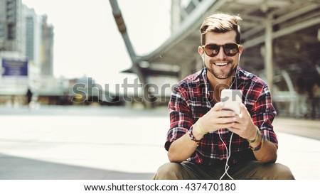 Man Sitting Listening Music Earphones Concept