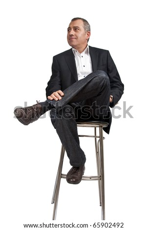 Man sitting on bar chair - stock photo