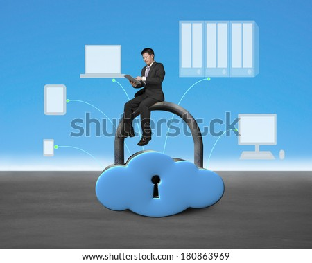 Man sitting on cloud shape lock with device drawings