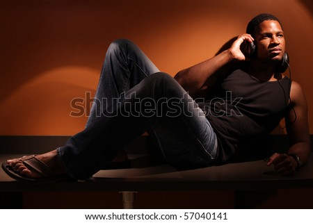 Man sitting on countertop with Headphones on