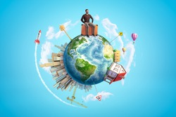 Man sitting on suitcase on small earth globe with buildings on blue sky background. Holidays and vacations. Creative process. Summer plans.