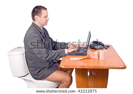 man sitting on the toilet in office