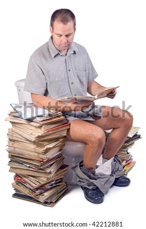 man sitting on the toilet. man reads a newspaper while sitting on the toilet. The reader is sitting on a toilet bowl. The man on the toilet reading a stack of magazines isolated on white background.