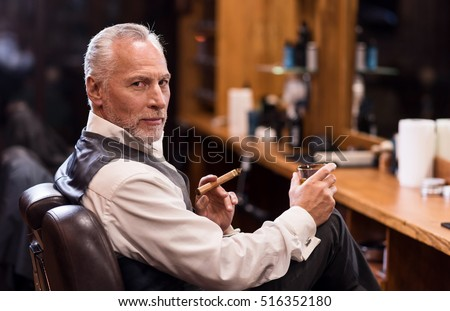 Man sitting with cognac glass and cigar #516352180