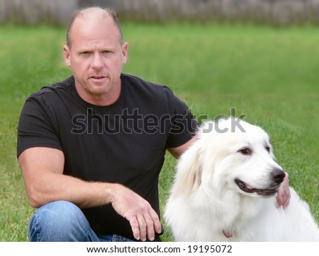 Man sitting with his Great Pyrenees dog