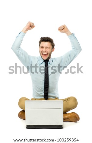 Man sitting with laptop with arms raised
