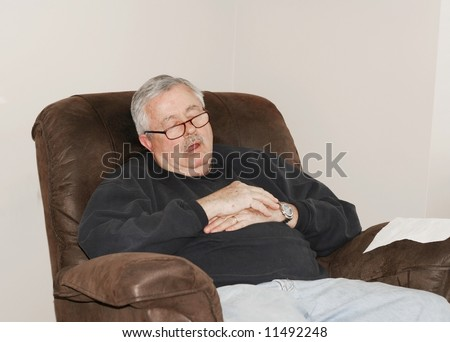 stock-photo-man-sleeping-in-his-lounger-