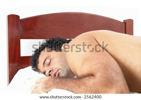 stock photo : Man sleeping like a bear in a single bed.