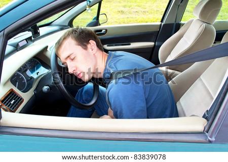 man sleeps in a car