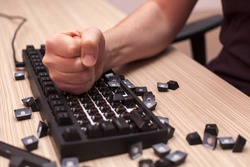 Man smashes a mechanical computer keyboard in rage using one fist