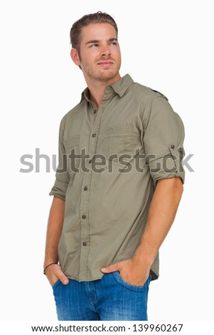 Man smiling and looking away on white background